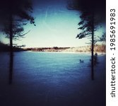 grungy image of frozen lake... | Shutterstock . vector #1985691983