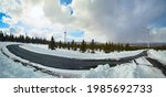 snowy road in amliden wind park ... | Shutterstock . vector #1985692733