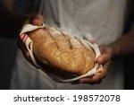 baker man holding a warm bread | Shutterstock . vector #198572078