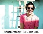 young man with headphones... | Shutterstock . vector #198585686