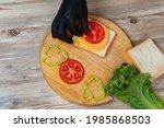 a man prepares lunch  serves a...   Shutterstock . vector #1985868503