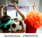 family with football watching... | Shutterstock . vector #198593576