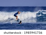 Surfer School. A Young Guy...