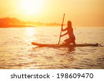 Silhouette Of Paddle Surf Yoga...