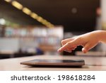 hand pointing to tablet... | Shutterstock . vector #198618284
