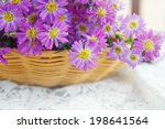 Small photo of Purple flowers, sweet purple flowers on an old wood background.