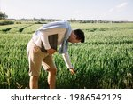 Young Farmer With Folder Under...