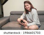young happy woman laughing and...   Shutterstock . vector #1986601703