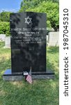Small photo of Arlington VA, 05 28 2021. Grave of Associate Supreme Court Justice Ruth Bader Ginsburg and her husband MD Ginsburg, at Arlington National Cemetery. Justice Ginsburg's name is on the white marker.