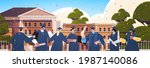 graduated students standing... | Shutterstock .eps vector #1987140086