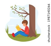 Boy Sits Under Tree And Reads...