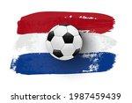 realistic soccer ball on flag... | Shutterstock .eps vector #1987459439