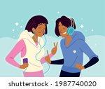 young couple with earphones...   Shutterstock .eps vector #1987740020
