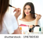 beauty woman applying makeup.... | Shutterstock . vector #198780530