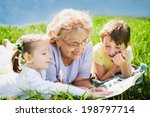 grandmother reading book to... | Shutterstock . vector #198797714