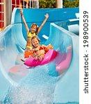 Children  On Water Slide At...