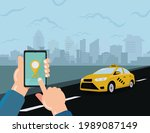 hand hold phone booking taxi... | Shutterstock .eps vector #1989087149
