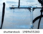 water pipe on dirty concrete...   Shutterstock . vector #1989655283