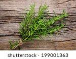 rosemary on wooden table... | Shutterstock . vector #199001363