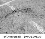 A Broken Asphalt Street With...