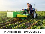 Farmer Digs Out A Crop Of...