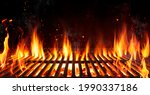Small photo of Barbecue Grill With Fire Flames - Empty Fire Grid On Black Background