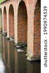 Aqueduct Pillars Reflecting In...