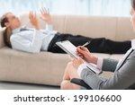 female psychologist noting down ... | Shutterstock . vector #199106600