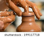 hands of a potter  creating an... | Shutterstock . vector #199117718