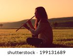 indian girl playing a flute at... | Shutterstock . vector #199131689