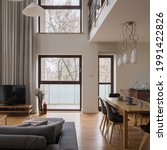 Small photo of Stylish and luxury living room with dining table, amazing big windows and mezzanine