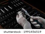 Repairman Hand In White Glove...