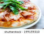 pizza parma ham and rocket | Shutterstock . vector #199159310