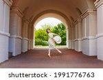 A Graceful Ballerina Girl Poses ...