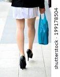 woman walking on sidewalk | Shutterstock . vector #199178504