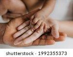 Asian Affrican Parent Hands...