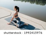 Peaceful Brunette Doing Yoga In ...