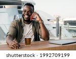 Young African Man Drinking Beer ...