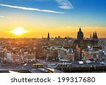 Stock photo sunset cityscape in winter of the skyline of amsterdam the netherlands 199317680