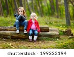 two little sisters sitting on a ... | Shutterstock . vector #199332194