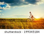happy young woman riding... | Shutterstock . vector #199345184