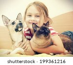 Stock photo child and pet 199361216