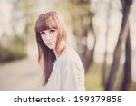 young girl posing in the street | Shutterstock . vector #199379858