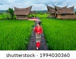 Asian Women Wearing Thai Dress...