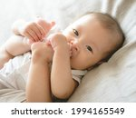 Closeup Adorable Infant Asian...