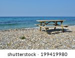 Picnic Table On The Beach Of...