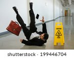 Senior Businessman Falling Nea...