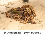 Pile Of Rusty Chains On A Beach