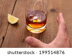 whiskey with ice cubes in glass ...