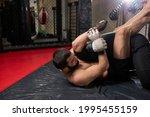 grappler trying to choke... | Shutterstock . vector #1995455159